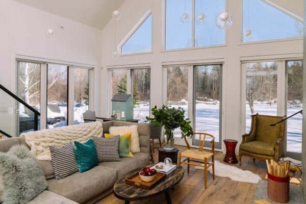 Buying a Home in Southern Georgian Bay- beautiful living room with a view of the outdoors covered in snow