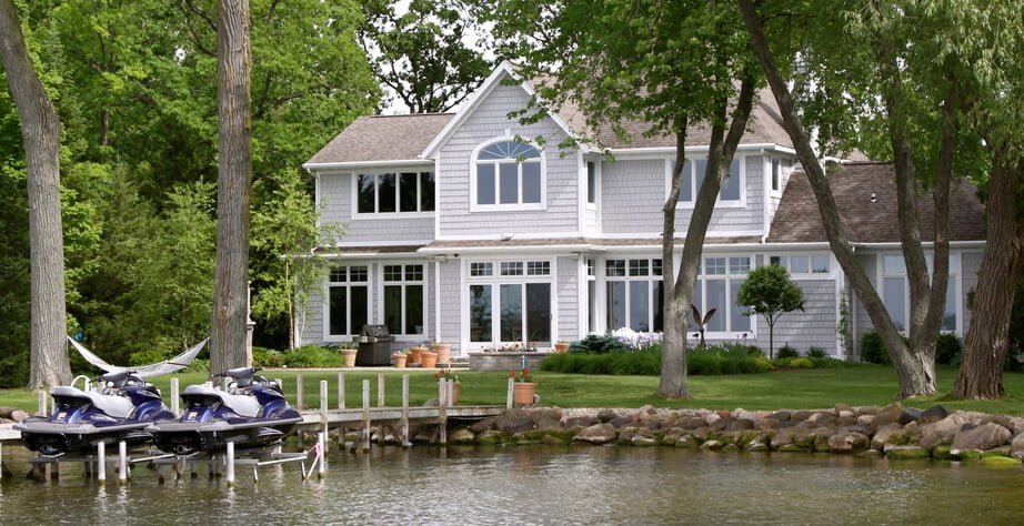 Top Questions to Ask When Buying Waterfront Property in Ontario- lovely cottage on a lake